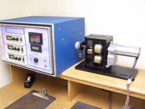 Test equipment testing finished gearbox for amperage draw and noise.