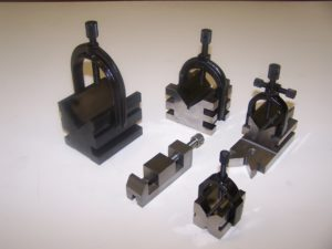"Precision ground V-blocks and clamps. Surface ground to .0003"" perpendicularity, parallelism and ""V"" centrality. Assembled and packaged for dock to stock availability."